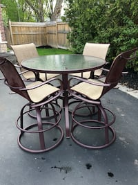 Round glass top table with four chairs patio set plus 4 matching lounge chairs and 2 side tables - originally paid over $6,000 for the set  Oakville, L6L 1Y3