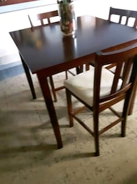 Bar height table three chairs