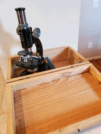 Microscope with slides in wooden box