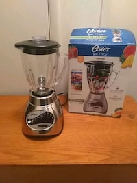 One clear glass blender with box,  35 km