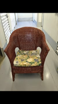 brown wicker armchair with floral cushion 38 km