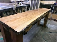 rectangular brown wooden table with chairs West Monroe