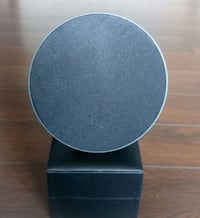 round black wooden table with gray metal base Richmond Hill, L4C