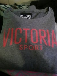 gray and red Victoria's Secret scoop neck shirt