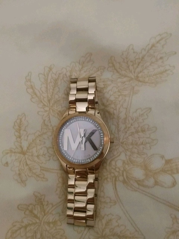 round silver Michael Kors analog watch with silver link bracelet