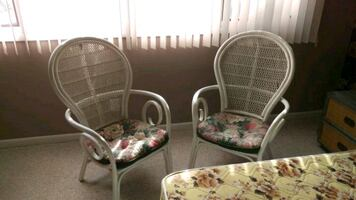 two white wicker armchairs