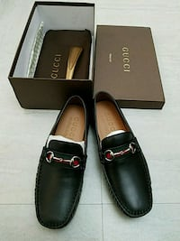 pair of black leather loafers with box New York, 10034