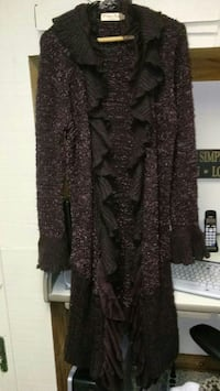 Size small but fits larger womens sweater coat. Ve