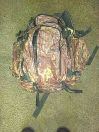 green and beige camouflage backpack