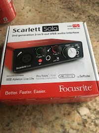 black and red Scarlett Solo USB audio interface box