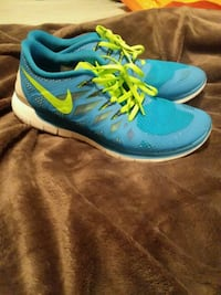 pair of blue-and-pink Nike running shoes