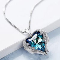 """Genuine white gold Blue sapphire surrounded by diamonds 18k with a locket and an 18"""" long chain Toronto"""