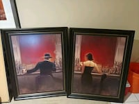 two black wooden framed painting of people Boynton Beach