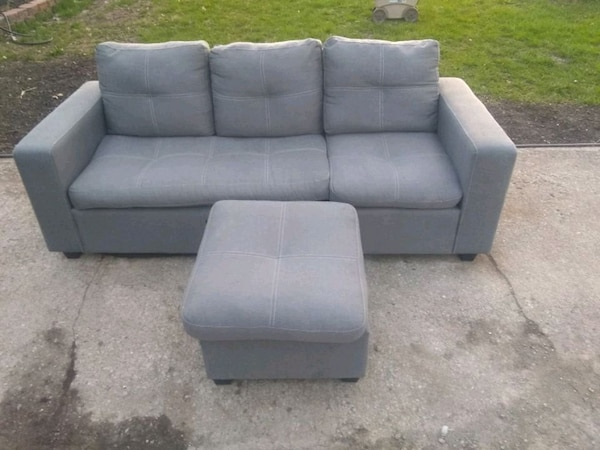 gray fabric sectional sofa with ottoman