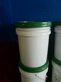 white and green plastic container 536 mi