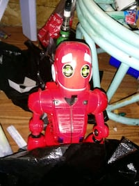 red and white plastic toy 1459 mi