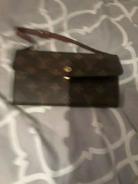 Louis vuitton clutch with strap Fridley, 55432