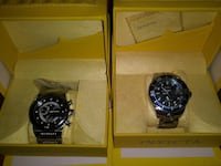 two round black Invicta chronograph watches with yellow box New Castle, 19720