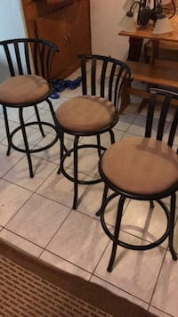 two brown padded bar stools with black steel frames 2232 mi