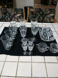 clear glass decanter with wine glasses