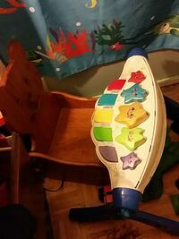 baby's brown wooden rocking chair Ontario, K2H 9S1