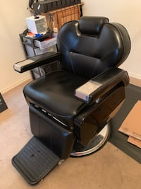 black leather padded office rolling chair