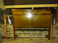 brown wooden bed headboard and footboard 535 mi