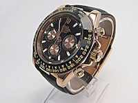 round gold-colored chronograph watch with black leather strap Brossard, J4W 2Y9