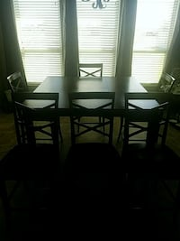 rectangular black wooden table with four chairs di Youngsville, 70592