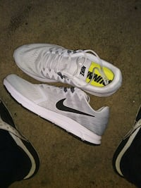 pair of white-and-gray Nike running shoes Tampa, 33618