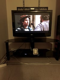 Black flat screen tv  lg  32 inches with black wooden tv stand Winnipeg, R2K 4A1