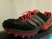 pair of black-and-red Adidas running shoes St Louis, 63135