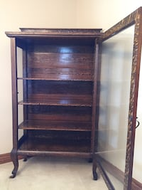 Tall antique display cabinet