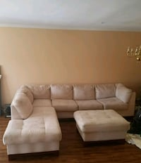 Off white fabric sectional sofa and Ottoman 65 km