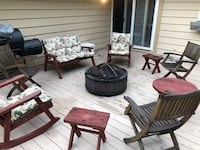 two brown wooden framed padded armchairs Gurnee