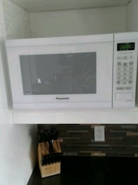 white General Electric microwave oven Gatineau, J8P 1B3