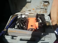 orange and gray power tool in case Riverside, 92509