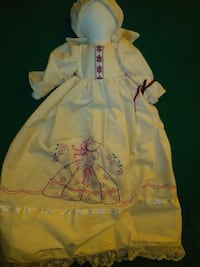 Handmade, hand-embroidered cloth baby doll