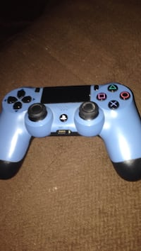 White Sony PS4 dualshock controller
