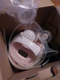 white Spectra electric breast pump with box