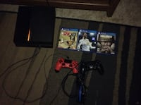 Sony PS4 console with controller and game cases