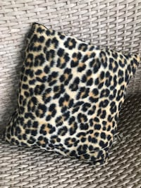 beige and black leopard throw pillow