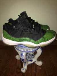 pair of green-and-black Air Jordan 11 Kenosha, 53140
