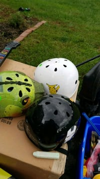 three white, green, and black bicycle helmets Martinsburg, 25403