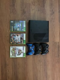 black Xbox 360 console with controller and game cases Miami, 33127