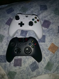 black Xbox One controller with white controller Edmonton, T5T