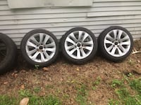 Three tires and wheels off of BMW