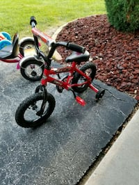 toddler's red and black bicycle with training wheels Chicago, 60623