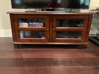brown wooden TV stand with flat screen TV 2374 mi