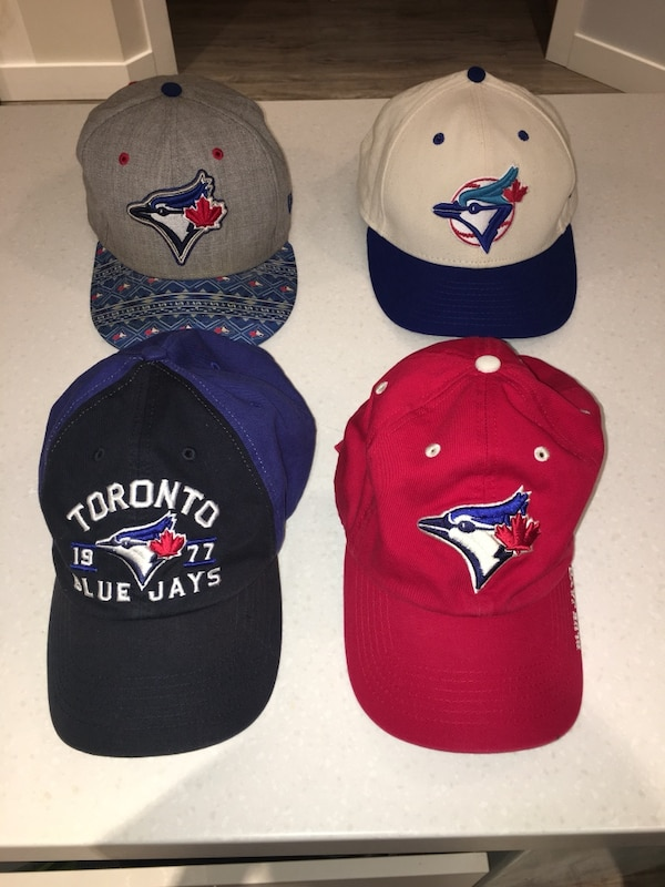 JAYS baseball hats-back row 15$ each front row 10$ each -all really good condition f2ef20b4-bdb8-4957-be30-0956601d648a